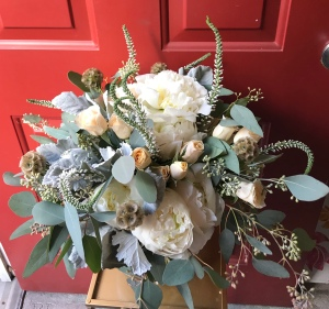 Bohemian bouquet of ivory peonies, peach spray roses, scabiosa pods, veronica and eucalyptus