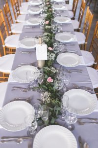 $119 - centerpiece reception table garland of greens, baby's breath and spray roses