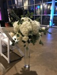 $121 - tall white and green reception centerpiece repurposed in aisle