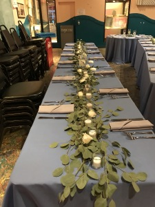 $145 - reception centerpiece garland of loose greens, roses and votive candles