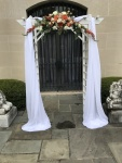 $297 - ceremony rental arch (included), draping, florals