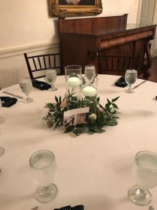$36 - floating candles & greens centerpiece for reception