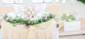 $47 - sweetheart table garland and repurposed bouquet for reception