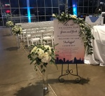 $75 - repurposed tall centerpieces as aisle décor