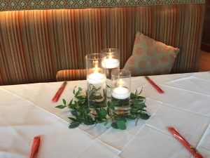 3 floating candles with loose greenery, rental candles